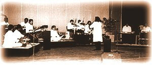 Rajan conducting his orchestra, Malabarians.
